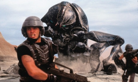 1997 - MOVIE, FILM - STARSHIP TROOPERS. ACTOR CASPER VAN DIEN FACES GIANT TANKER BUG. PHOTO CREDIT: COLUMBIA/TRISTAR PROMOTIONAL HANDOUT  *Calgary Herald Merlin Archive*